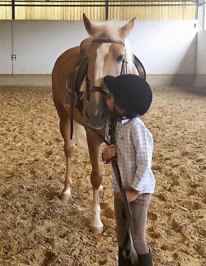 Beso equitación